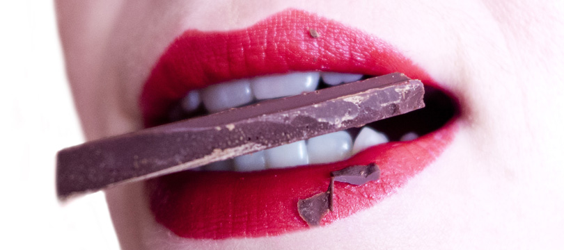 woman-eating-chocolate-with-teeth
